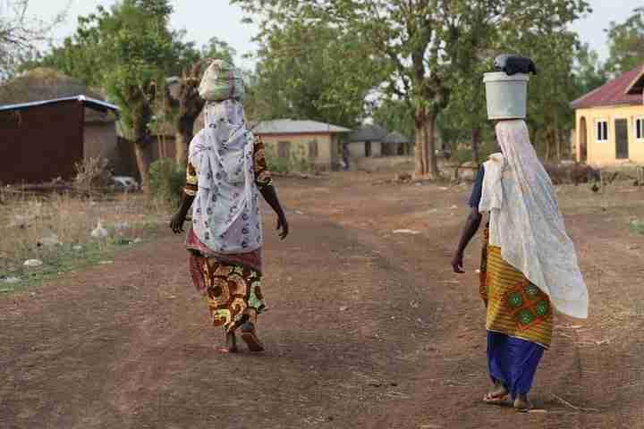 Women Walking Ghana By Juris Kornets