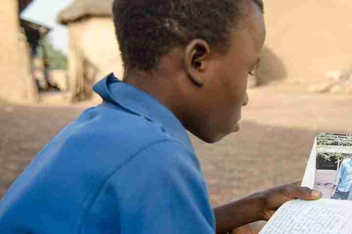 Boy reading letter