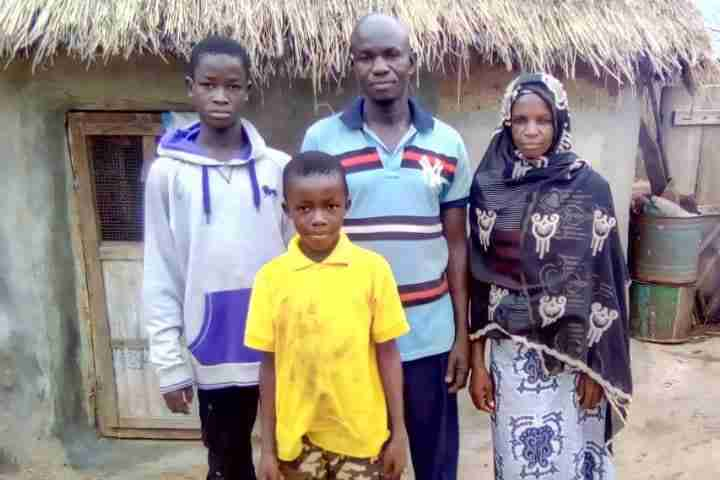Family in front of their home in Ghana