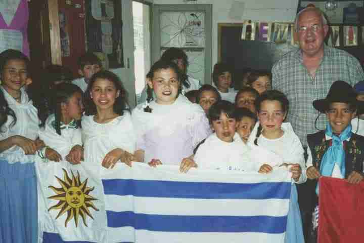Peter with children and Nicaragua flag