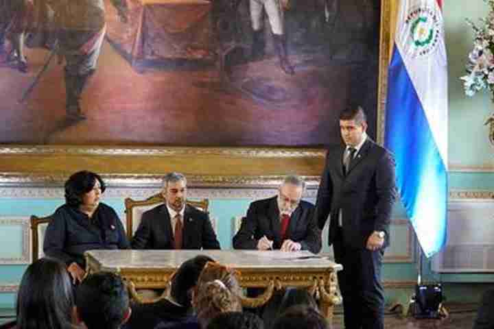 Three people sign document