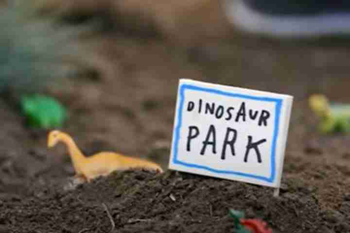 Toy dinosaurs in dirt