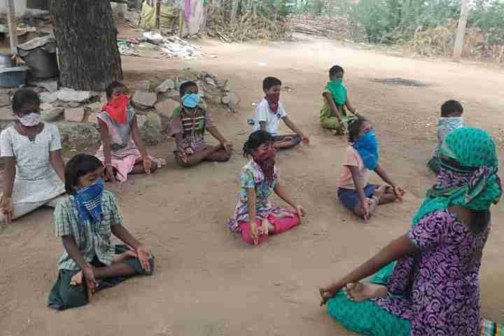 Children practise yoga outside