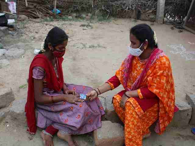 One woman test another woman's oxygen level