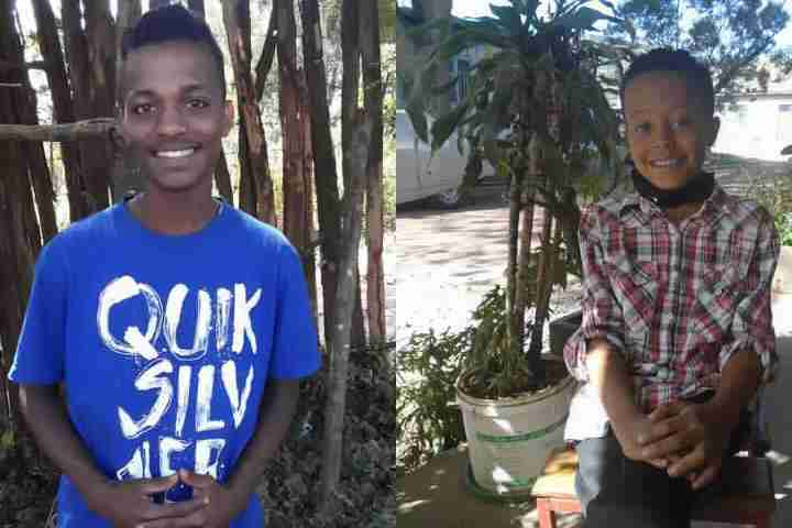 Two child sponsors in Ethiopia smile for camera