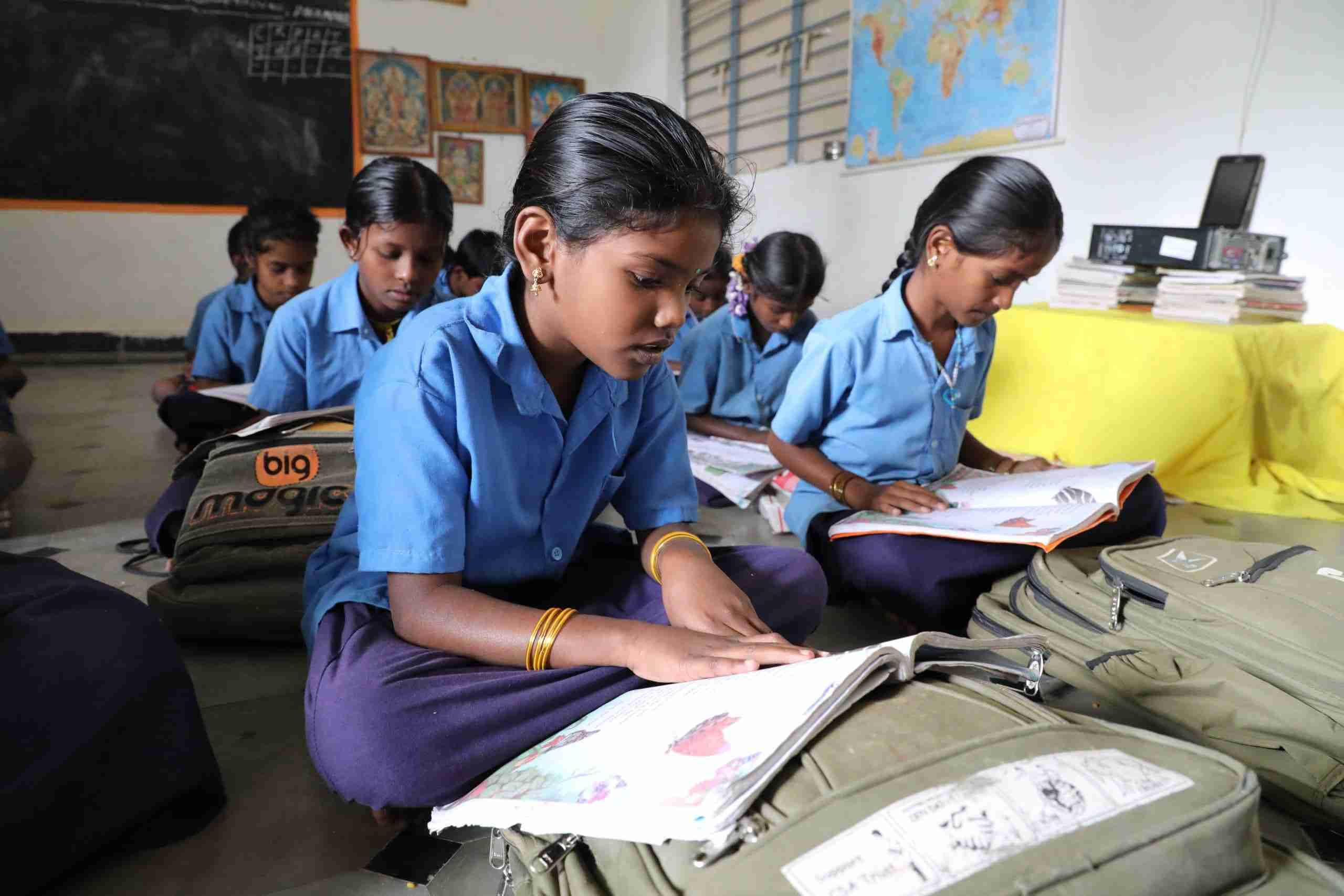 girls read in their classroom in rows