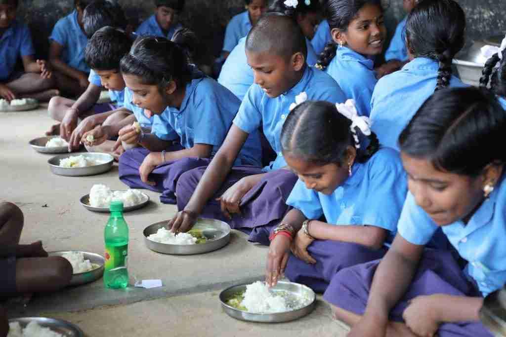 Children eat rice at school