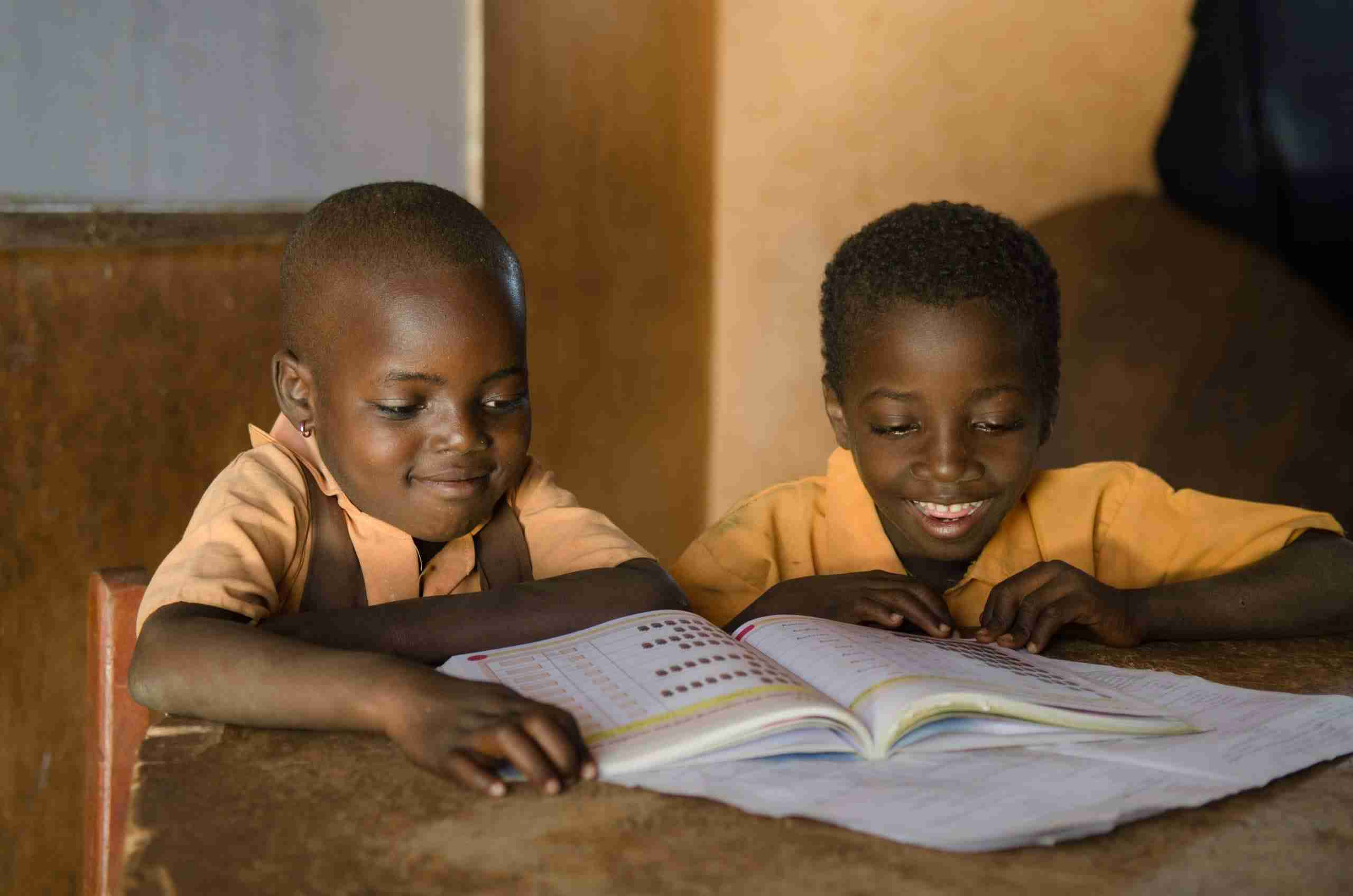 Boy and girl read on desk