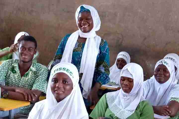 teacher smiles in class with her students