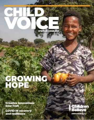 ChildVoice spring cover with boy holding tomatoes